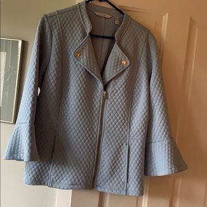 Blue quilted jacket with pockets